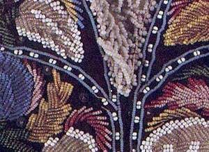 detail of a beaded shelf valance